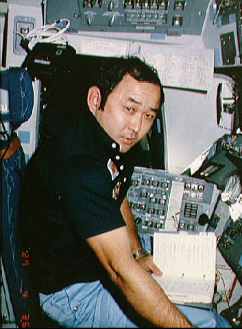 Ellison Onizuka Sitting at the Space Shuttle Commander's Station
